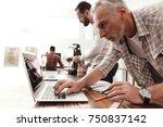 three men set up a self made 3d ... | Shutterstock . vector #750837142