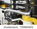 robot bending pipe in modern... | Shutterstock . vector #750869692