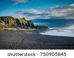 Black Beach And Sea Stacks In...