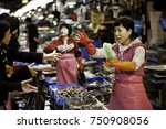 Small photo of Seoul, South Korea - April 9, 2012: Vendors at the Noryangjin Fisheries Wholesale Market. The seafood market covers an area of over 66,000 square meters and has over 700 shops
