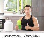 sporty young man with protein... | Shutterstock . vector #750929368