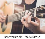 closeup of the girl is playing... | Shutterstock . vector #750933985