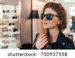 happy woman buying sunglasses... | Shutterstock . vector #750937558