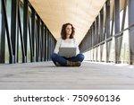 young beautiful woman sitting...   Shutterstock . vector #750960136