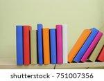 books on the shelf   Shutterstock . vector #751007356