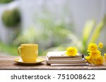 yellow cup and yellow... | Shutterstock . vector #751008622