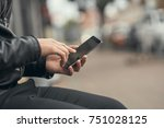 close up. the guy is holding a... | Shutterstock . vector #751028125