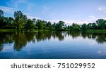 trees and sky reflecting in a... | Shutterstock . vector #751029952
