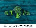 brocoli on a wooden surface.... | Shutterstock . vector #751037512
