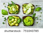 fresh avocado toasts with... | Shutterstock . vector #751043785