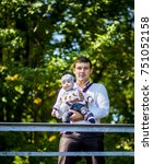 beautiful father holds his... | Shutterstock . vector #751052158