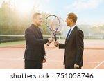 two businessmen in suits... | Shutterstock . vector #751058746