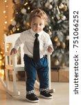 happy little boy sitting near... | Shutterstock . vector #751066252