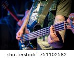 Small photo of Bass guitarist clamps the chord with his finger on the guitar during the concert