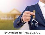 real estate agent holding keys... | Shutterstock . vector #751125772