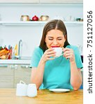 laughing woman sitting in home... | Shutterstock . vector #751127056