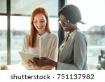 two businesswomen looking at a