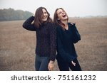 Two Young Woman Laughing And...