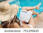 woman in straw hat reading a... | Shutterstock . vector #751190635