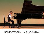 japanese boy playing piano on... | Shutterstock . vector #751200862