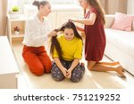girlfriends doing hairstyle | Shutterstock . vector #751219252