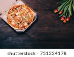 pizza in a box and a bouquet of ...   Shutterstock . vector #751224178