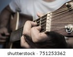 play the guitar by hands ... | Shutterstock . vector #751253362
