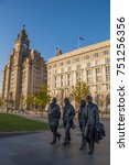 Small photo of LIVERPOOL, ENGLAND - May 7, 2017 : The Beatles statue at the Pier Head Liverpool, Liverpool, England, United Kingdom
