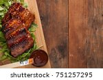 closeup of pork ribs grilled... | Shutterstock . vector #751257295