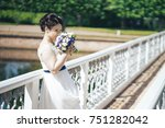 bride in wedding dress with... | Shutterstock . vector #751282042