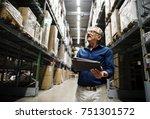 a caucasian man checking stock... | Shutterstock . vector #751301572