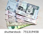 saudi arabia money on wooden... | Shutterstock . vector #751319458