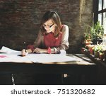 caucasian woman working  | Shutterstock . vector #751320682