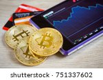 golden bitcoins liyng on the... | Shutterstock . vector #751337602