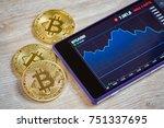 golden bitcoin and smartohone... | Shutterstock . vector #751337695