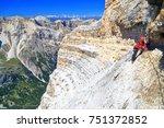 woman climber ascending along... | Shutterstock . vector #751372852