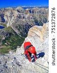 woman climber ascending along... | Shutterstock . vector #751372876