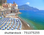 blue umbrellas aligned on a... | Shutterstock . vector #751375255