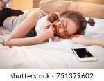 Stock photo bedroom concept of relaxation with technology a beautiful woman use cell phone and playing with 751379602