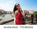 beautiful girl with red dress... | Shutterstock . vector #751382662