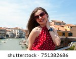 beautiful girl with red dress... | Shutterstock . vector #751382686