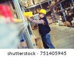 worker in warehouse preparing...   Shutterstock . vector #751405945