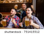 men fans watching football on... | Shutterstock . vector #751415512
