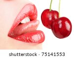 sensual lips with a cherry - stock photo