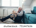 mature man playing with...   Shutterstock . vector #751447636