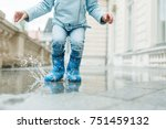 girl jumping in a puddle legs | Shutterstock . vector #751459132