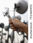 Small photo of Adjustable spanner wrench with telco tower background