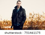 handsome young man in leather... | Shutterstock . vector #751461175