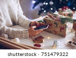 young woman preparing gifts and ... | Shutterstock . vector #751479322