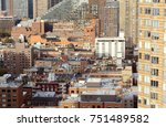 Small photo of Cityscape of apartment and office buildings in Hell's Kitchen, New York City. Diverse architectural styles among tall skyscrapers.